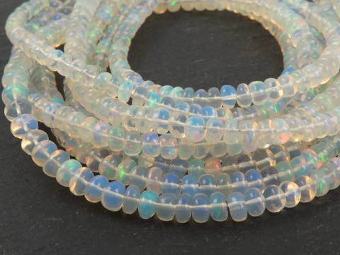 AA+ Ethiopian Opal Smooth Rondelle Beads 3.25-6.25mm ~ 16'' Strand
